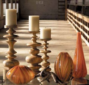 "Tall, mid-century modern interpretations of natural pine wood is are crafted into turned wood candlesticks.  The candle holders have a polished nickel base to hold a candle up to four inches in diameter,  low 6 1/2"" diameter by 14"" high medium 6 3/4"" diameter by 17"" high tall 6"" diameter by 19 1/2"" high"