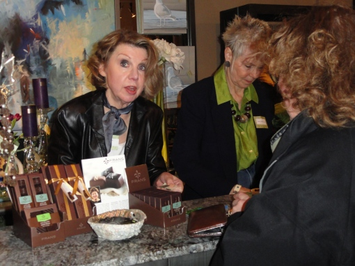 Caught doing business:  Denise Fairweather offering a suggestion to an art patron.