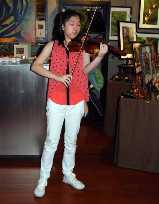 The season's finale,  Kirsten Qian, violinist, playing dramatic and sweeping music.