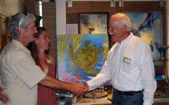 """The GUYS TAKE OVER Art Walk sponsored a charitable cause close to the hearts of many, especially those that live and breathe near the sea. Marc Ward thanks Paul Brent, artist, for creating art titled """"Sea Turtle Sea""""."""