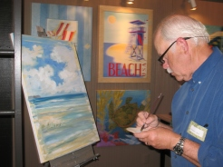 Paul Brent painting LIVE at Fairweather's during MOMENTS, the Art Walk.