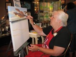 Painting Seaside LIVE (tm) artist Carol Thompson.