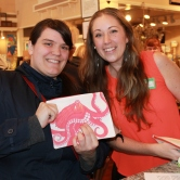 Art patron (visiting the Oregon coast from Colorado) selected Britney Drumheller's octopus art.