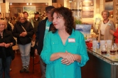 Artist Linda Trexler in bright ocean blue spoke to art patrons.