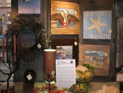Salon-style display featuring artist Paul Brent