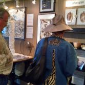 Patrons viewing museum style display