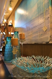 Glass coral by Rinee Merritt, Driftwood art by Robert McWhirter and original art by Kimberly Reed.