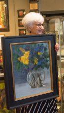 Joan displays art by Melissa Jander.