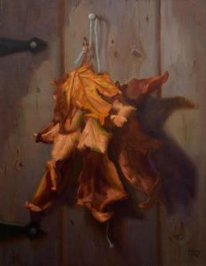 An oil painting of leaves tied with string and hung on a door nail