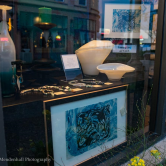 Front window display with Nick Brakel's art.
