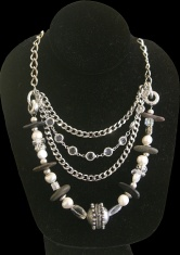 Polished beach stones and chain metal