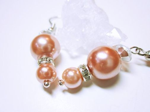 Pinkie-peachie pearl earrings by Mary.