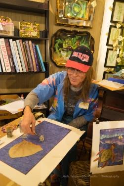 Mike Mason offering an artist demonstration using art from flower petals.