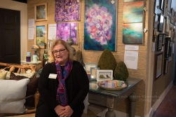 Diane Copenhaver posing with her art.