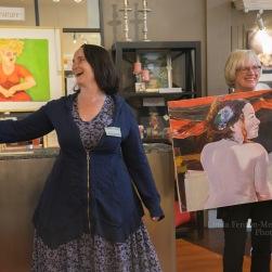 Leah Kohlenberg shares a laugh with art patrons.