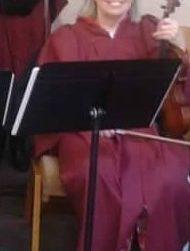Sharon Johnson plays the violin.