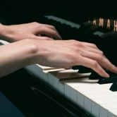 lady hands on a piano